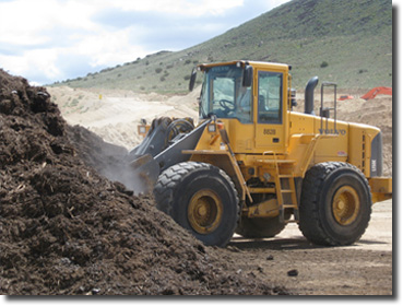 Loading out of a stockpile of ground greenwaste